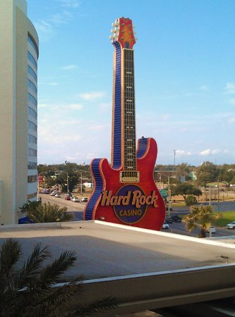 Hard Rock Hotel & Casino Biloxi: Hard Rock Logo in Neon - day time.  Platinum Tower newly opened, left.