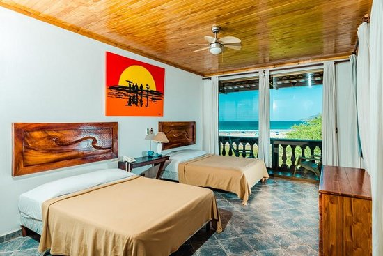 Witch's Rock Surf Camp: Double room with a beautiful balcony view.
