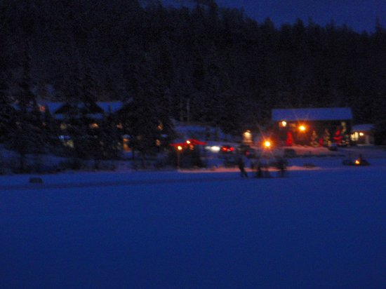 Pyramid Lake Resort : Pond hockey, Canada style & Hotel at night from the lake