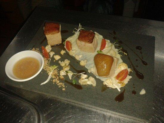 Capriccio Italian Restaurant & Pizzeria: Marinated pork belly,  cauliflower: puree, snow (dried) and sauté., onion jus