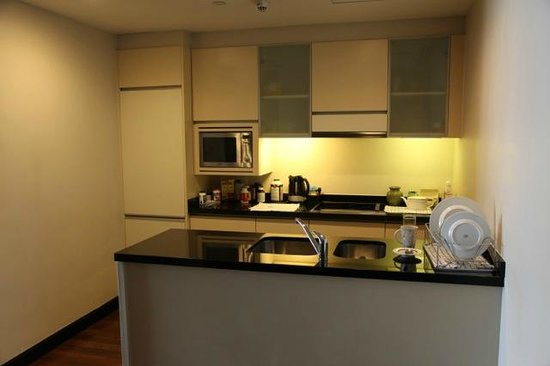 Fraser Suites Sukhumvit: kitchen area / with washing machine and micro wave and refridge