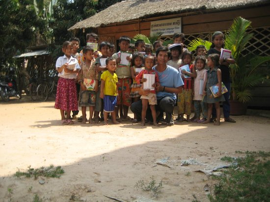 Angkor Forever Tours -Day Tours: I love children that they want to study so I was giving the books and pencils.