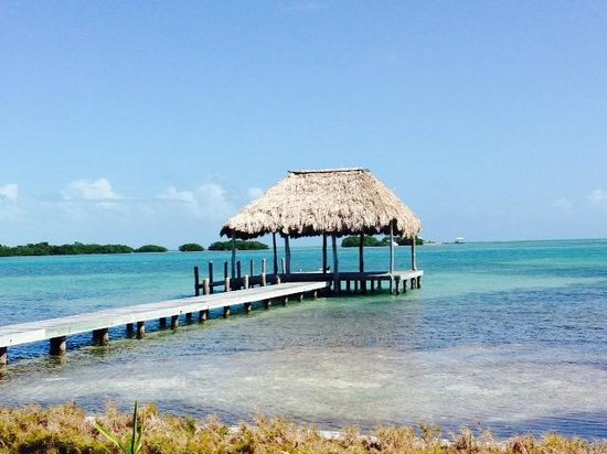 St. George's Caye Resort: pier and emerald water