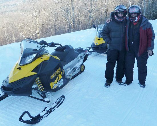 Northern Extremes Snowmobiling - Tours: Father and son fun!