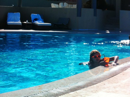 Majestic Hotel : this is me by the pool side with a yummy milkshake !
