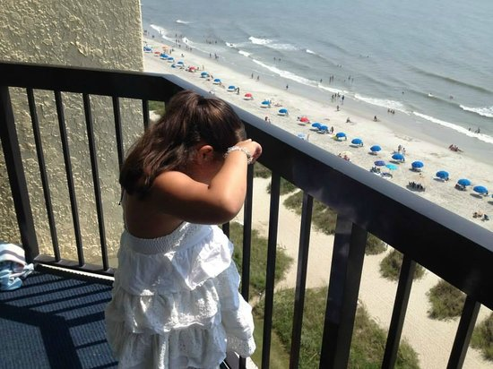 Compass Cove Oceanfront Resort : Looking for her Aunt on the beach!