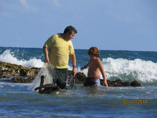 El Pez: My son with a fisherman