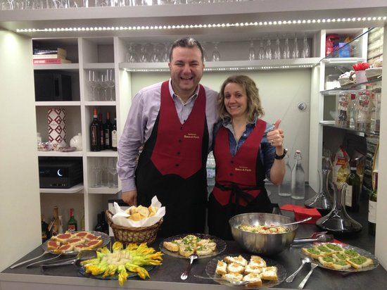 Agriturismo Rocca di Pierle : Andrea and Silvia with the incredible spread for the wine tasting!