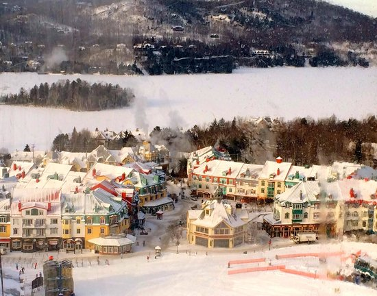 Fairmont Tremblant : The village at Mont Tremblat with the lake behind it covered in snow