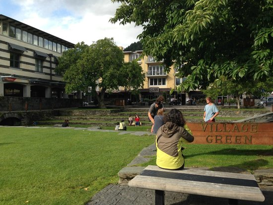 Novotel Queenstown Lakeside: the Village Green. Lots of music and people just relaxing about