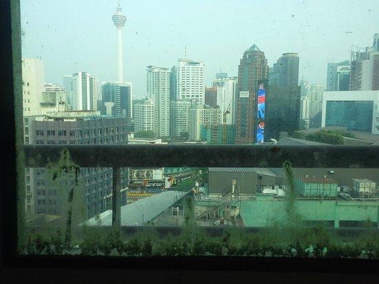 Hotel Royal Kuala Lumpur: View of the city through dirty windows