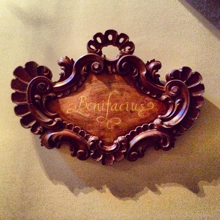 Guesthouse Bonifacius' beautiful carved wooden sign in the entrance hall