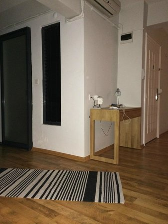 212 Istanbul Suites: Door to bathroom, the apartment door and writing table