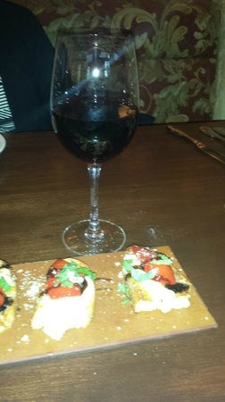 BRIO Tuscan Grille: Roasted Red Pepper Bruschetta with a Glass of Chianti