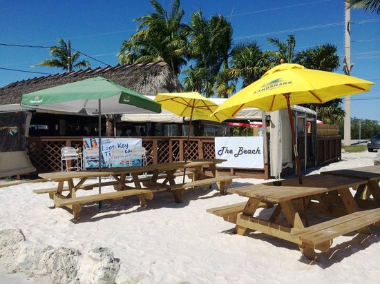 Looe Key Tiki Bar & Grill: Enjoy a drink or takeout meal at our new Tiki Beach! It's the only beach on Ramrod Key ;)