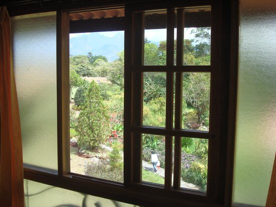 Hotel Dos Rios : in-room view through windows; sliding door needed a screen though. Mountains in the background :