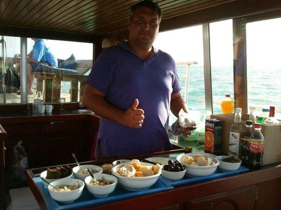 Strea Charters: Captain John preparing sunset snack platters