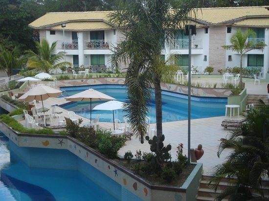 Portal do Mundaí Praia Hotel : vista da piscina no corredor para o quarto.
