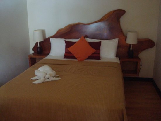 The Resort at Isla Palenque: Our bed, headboard made from fallen logs on the island!