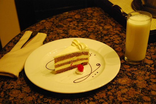 The Royal Haciendas All Suites Resort & Spa: Room service on the first night - yummy carrot cake and milk