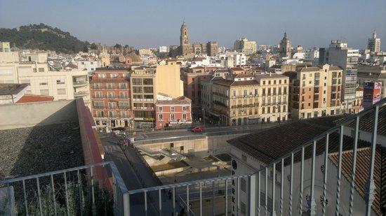 Salles Hotel Malaga Centro: View from rooftop terrace over the Rio Guadalmedina to the city center.
