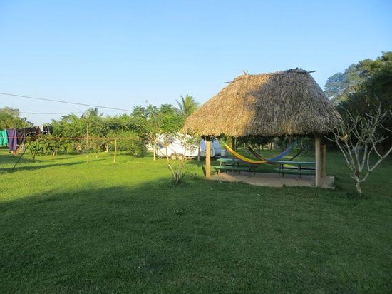 River Park Inn: the garden palapa, with table to sit  and hammocks to laze about