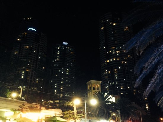 Mantra Towers of Chevron: street view at night of the three towers