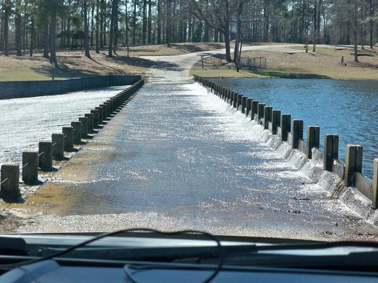 Paul B. Johnson State Park: Lake water spilling over the roadway into the park