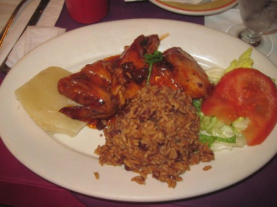 Cuzzin's Caribbean Restaurant and Bar: Barbeque Chicken with Black Beans and Rice and St. Thomas special sweet potato