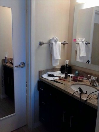 TownePlace Suites Ann Arbor: Bathroom sink area, through the door is small tub/shower and toilet