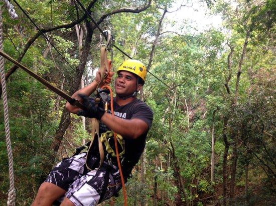 Piiholo Ranch Zipline: Guide Ikaika, showing off his skills