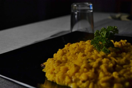 Osteria Spacciodivino: Risotto con zafferano porcini mantecato alla fontina
