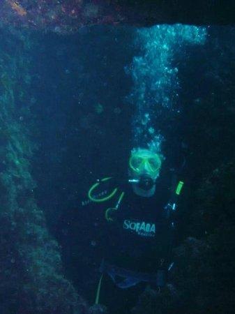 Dawn Diving: Me at a Swim Through