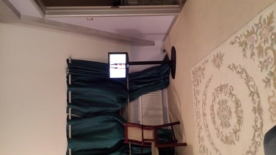 Cricklade House: This is where the sofa is and look how small the tv is! need glasses