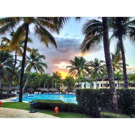 Iberostar Costa Dorada : Sunset over pool.