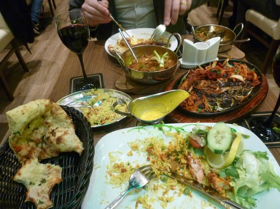 Vinyasa: A small table packed with food....