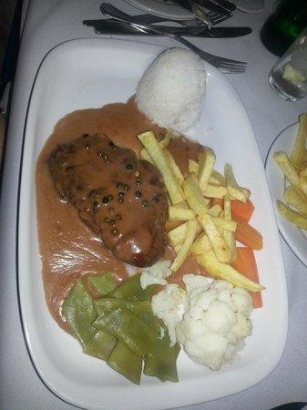 Steak with peppercorn sauce