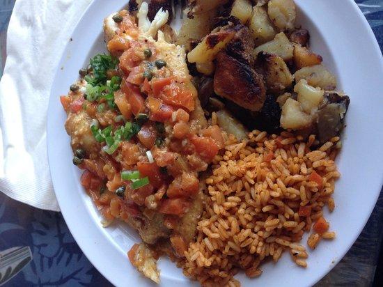Reel Inn: Sautéed tilapia, Cajun rice, potatoes - as seen on TV!  Delicious