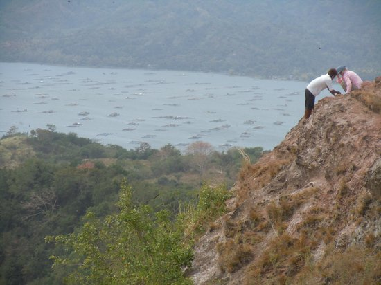 Taal Volcano: Top of the steam vents with view of fish farms below. That guy is taking a big risk