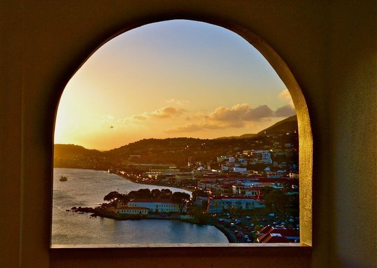 Bluebeard's Castle Resort: Sunset view of Charlotte Amalie from the fourth floor archway at the hotel.