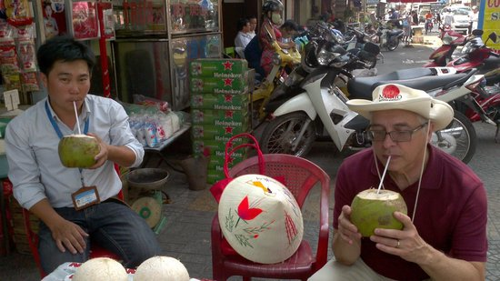 Footprint Vietnam Travel Day Tours: A pause to drink fresh coconut juice in Ho Chi Minh city