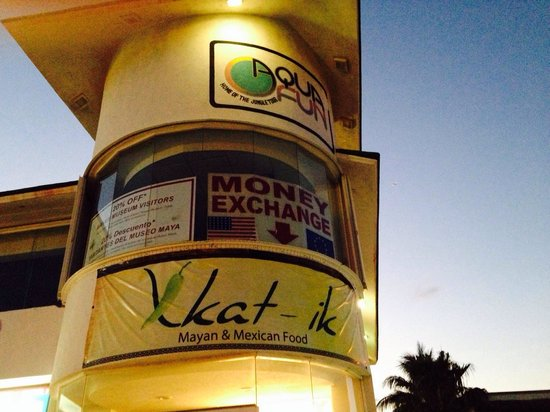 Xkat Ik Tucked Behind The Convenience Signage Is Above Money Exchange