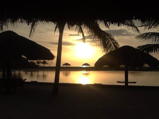 Parrot Tree Plantation : Stunning Sunrise taken from the Palapa
