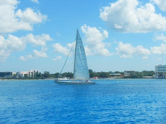 Fury Catamarans - Tours: a passing sailboat