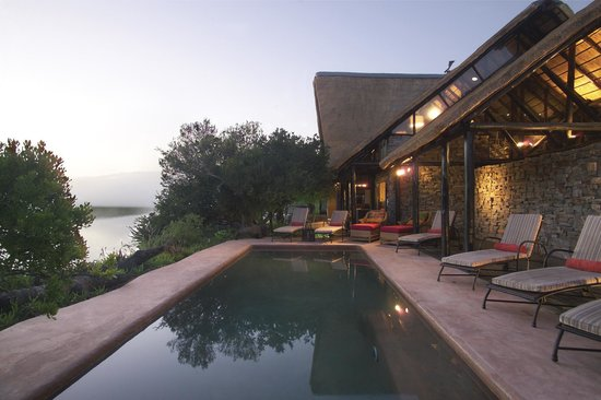 Kariega Game Reserve - River Lodge: River Lodge pool, lodge area and river view