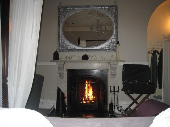 The Castle House : gorgeous fireplace view from bed