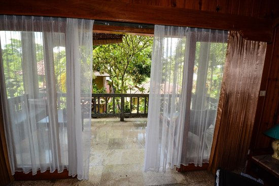 sliding doors with curtains to the balcony - Picture of Cendana ...