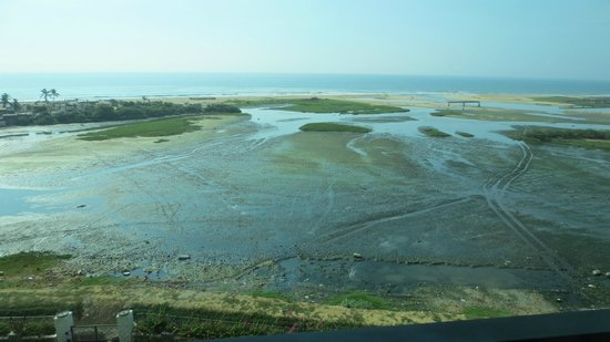 The Leela Palace Chennai: view from room at low tide showing mud flat