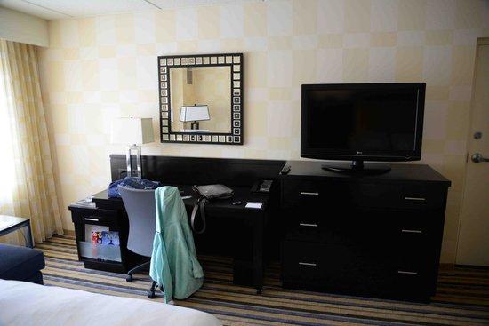 The Baronette Renaissance Detroit-Novi Hotel: TV Desk in room. WiFi not free.