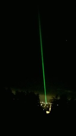 Kaskaden: Scenic view over Kassel, The  laser ray comes from the Friedericianum and points at the Herkules
